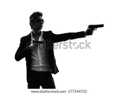 one asian gunman killer portrait  shooting in silhouette isolated white background - stock photo