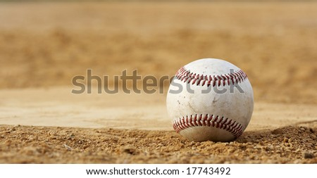 one baseball on home plate at a sports field - stock photo
