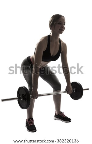 one beautiful fitness woman sport exercising deadlift with dumbbells silhouette on white background - stock photo