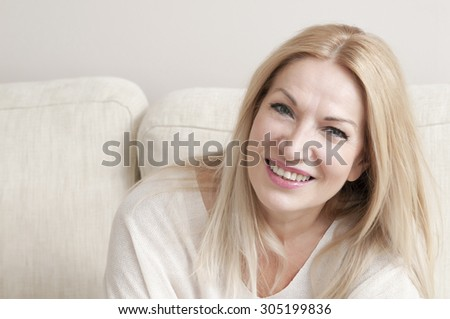 one beautiful woman in her apartment - stock photo