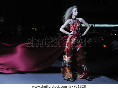one beautiful young elegant woman in fashion and urban style dress in  city on  street at night alone - stock photo