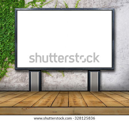 One big blank billboard attached to a ivy wall with wooden floor - stock photo