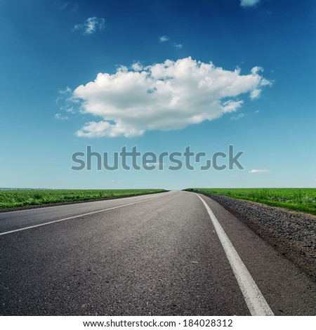 one big cloud and asphalt road