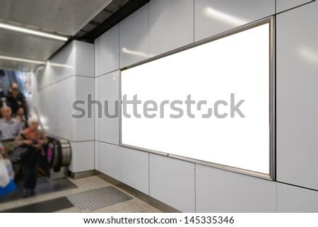 One big horizontal / landscape orientation blank billboard with escalator and passenger background - stock photo