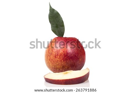 One big red ripe juicy apple with a slice bitten - stock photo
