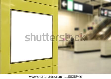 One big square blank billboard on modern yellow wall with escalator background - stock photo