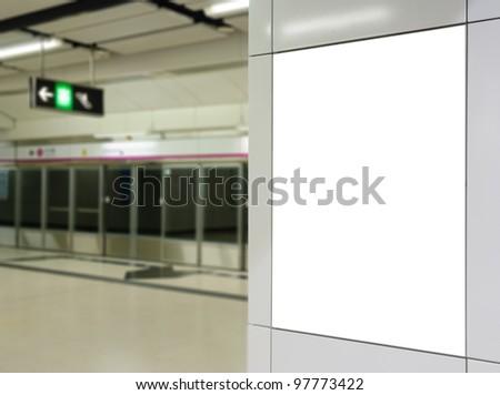 One big vertical / portrait orientation blank billboard on modern white wall with platform background - stock photo