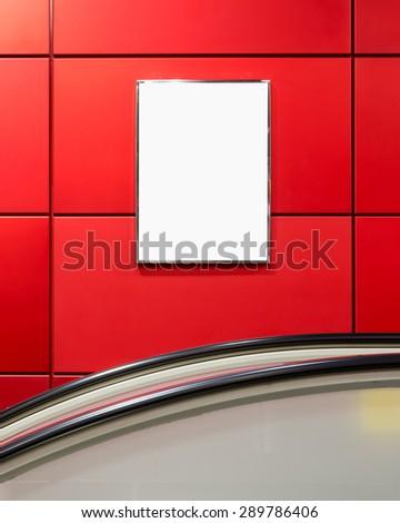 One big vertical / portrait orientation blank billboard with escalator background - stock photo