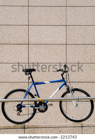 One bike on the parking with marble wall