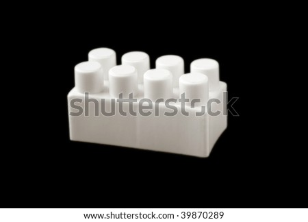 one bit of lego on black background - stock photo