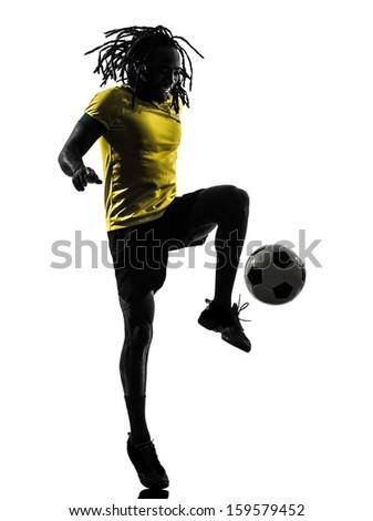 one black brazilian soccer football player man in silhouette studio  on white background - stock photo