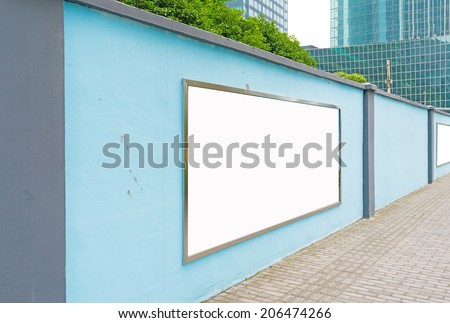 one blank billboard attached to a buildings exterior brick wall - stock photo
