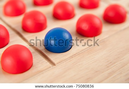 One Blue Marble with Lots of Red Ones Leadership Concept