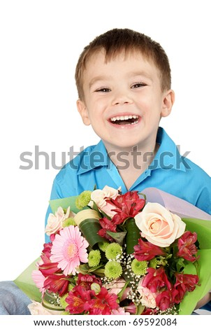 One boy with bouquet of miscellaneous flowers isolated on white background - stock photo