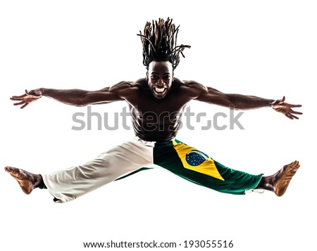 one Brazilian black man dancer dancing capoeira on white background - stock photo