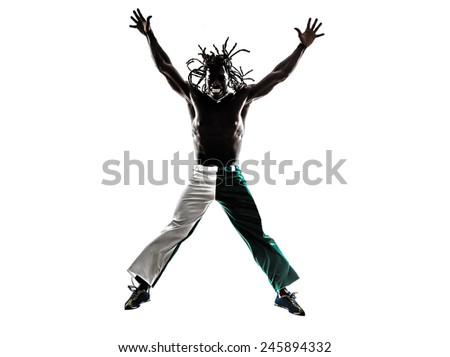 one Brazilian black man jumping arms outstretched on white background - stock photo