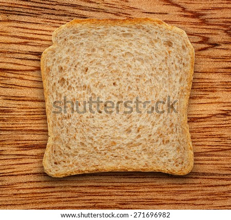 One bread slice on the wooden background