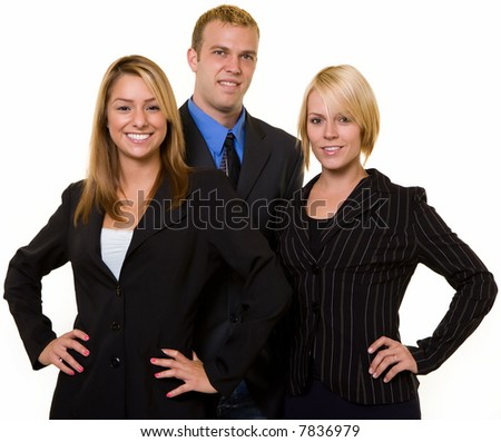 One business man in between two attractive confident business women both wearing dark colored business suits all smiling standing on white background