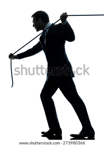 one  business man pulling a rope in silhouette studio isolated on white background - stock photo