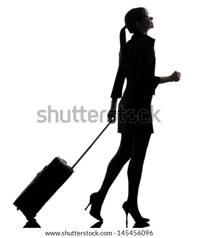 one business woman traveler walking   silhouette studio isolated on white background - stock photo