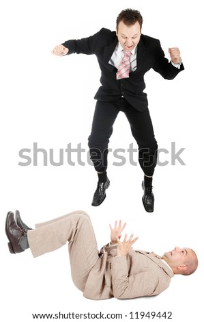 One businessman jumping on another businessman - stock photo