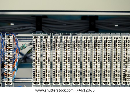 one busy switchboard panel and multitude of empty telephone panels - stock photo