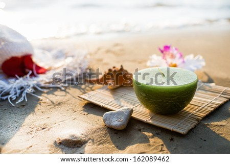 One candle at the sea, spa theme - stock photo