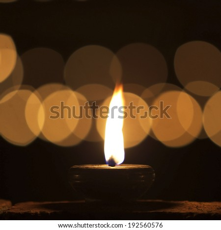 One candle flame at night closeup  - stock photo