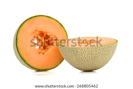 one cantaloupe cut in half on white background  - stock photo