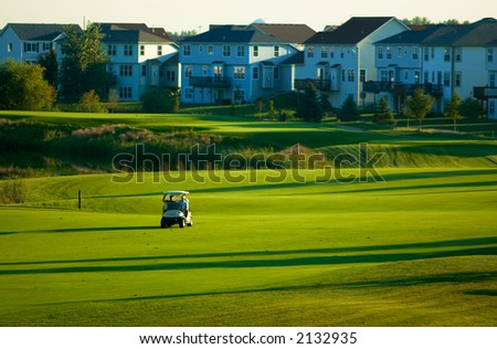 One cart running on the golf course. More with keyword group1a