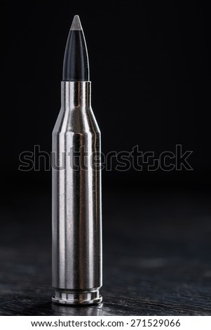 One cartridge with teflon bullet and silver sleeve - stock photo