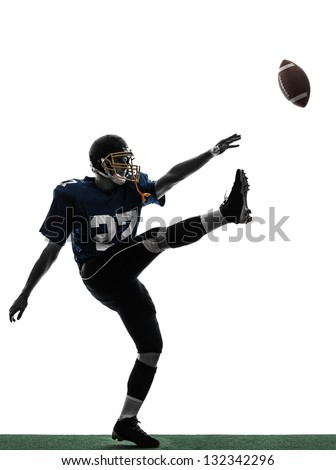 one caucasian american football player man kicker kicking in silhouette studio isolated on white background - stock photo