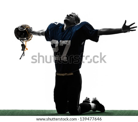one caucasian american football player man triumphant in silhouette studio isolated on white background - stock photo