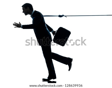 one caucasian business man catched by lasso rope  in silhouette studio isolated on white background - stock photo