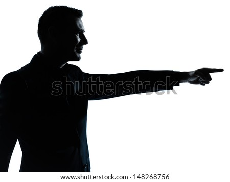 one caucasian business man pointing portrait silhouette in studio isolated on white background - stock photo