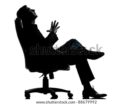 one caucasian business man relaxing thinking sitting in armchair silhouette Full length in studio isolated on white background - stock photo