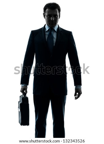 one caucasian business man serious holding briefcase in silhouette studio isolated on white background - stock photo