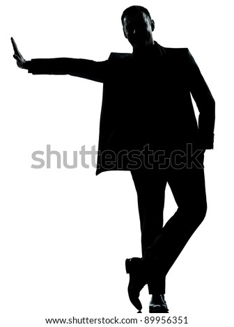one caucasian business man silhouette standing Full length in studio isolated on white background - stock photo
