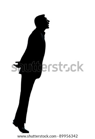 one caucasian business man silhouette standing tiptoe looking up Full length in studio isolated on white background