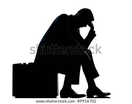 one caucasian business man sitting on suitcase tired despair silhouette Full length in studio isolated on white background - stock photo
