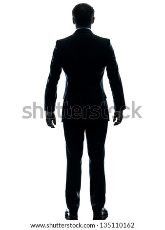 one caucasian businessman standing rear view  in silhouette studio isolated on white background - stock photo