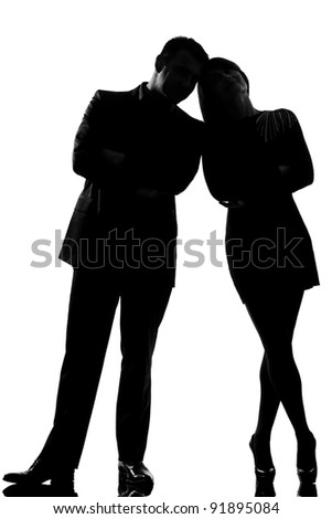 one caucasian couple man and woman standing face to face full length in studio silhouette isolated on white background - stock photo
