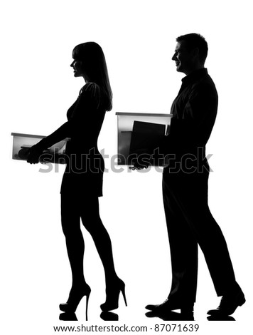one caucasian couple man and woman walking carrying boxes happy full length in studio silhouette isolated on white background - stock photo