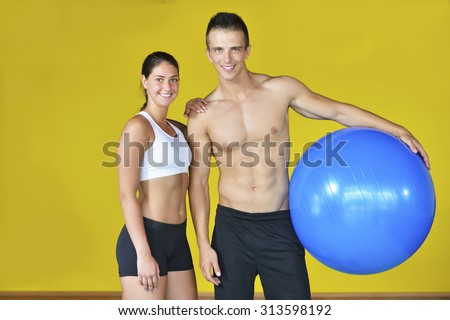 one caucasian couple man woman personal trainer coach exercising fitness ball  - stock photo