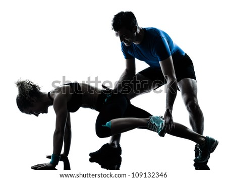 one caucasian couple man woman personal trainer coach exercising legs silhouette studio isolated on white background