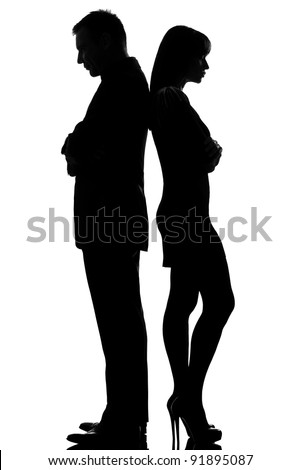 one caucasian couple standing back to back dispute conflict  man and woman sad in studio silhouette isolated on white background - stock photo