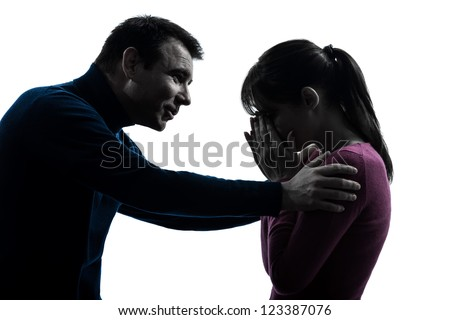 one caucasian couple woman crying man consoling  in silhouette studio isolated on white background - stock photo