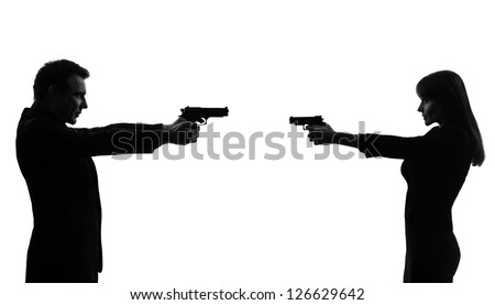 one caucasian couple woman man in duel   in silhouette studio isolated on white background - stock photo