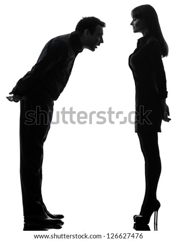 one caucasian couple woman seducing man in silhouette studio isolated on white background - stock photo