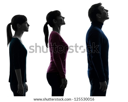 one caucasian family father mother daughter man looking up surprised in silhouette studio isolated on white background - stock photo